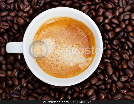 espresso cup in coffee beans stock photo, espresso cup in coffee beans, top view by Petr Malyshev
