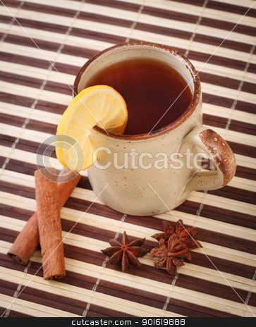 tea with cinnamon sticks and star anise stock photo, mug of winter tea with cinnamon and star anise on bamboo napkin by Petr Malyshev