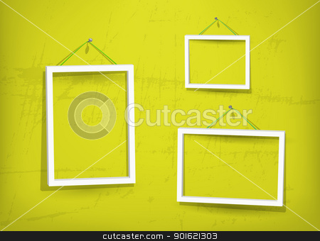 White frame on the wall stock photo, Three empty frame of picture on the yellow old wall. Eps10. Used opacity layers for effect of shadows by Imaster