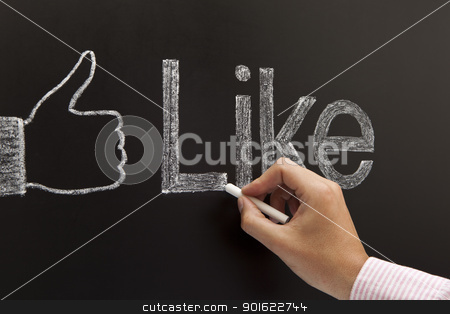 Hand drawing a thumbs up sign stock photo, Hand drawing a thumbs up sign with the word Like on a blackboard with white chalk.  by Ivelin Radkov