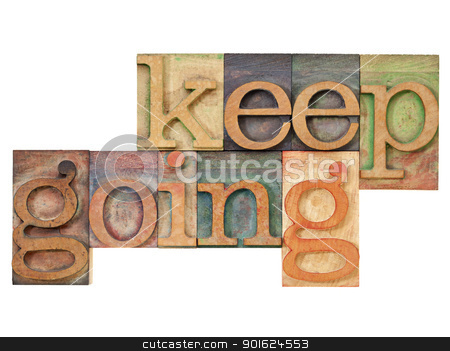 keep going - motivation  concept stock photo, keep going - motivation  concept - isolated text in vintage letterpress wood type by Marek Uliasz