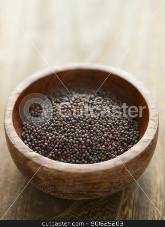 black mustard seeds stock photo, close up of a bowl of black mustard seeds by zkruger