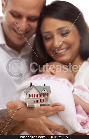 Mixed Race Family with Small Model House stock photo, Young Attractive Happy Mixed Race Family with Baby and Small Model House. by Andy Dean