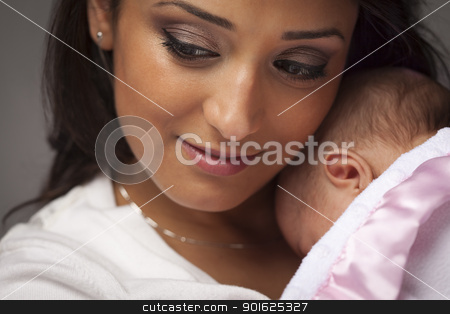 Attractive Ethnic Woman with Her Newborn Baby stock photo, Young Attractive Ethnic Woman Holding Her Newborn Baby Under Dramatic Lighting. by Andy Dean