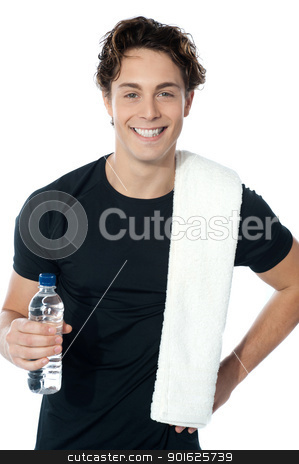 Handsome muscular man with towel stock photo, Handsome muscular man with towel holding a bottle of water by Ishay Botbol