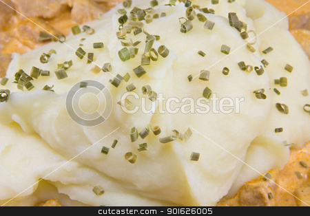 Mashed potatoes stock photo, Closeup picture of mashed potatoes on a dinner dish by Stian Olsen