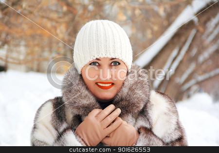 Beautiful young woman in winter coat stock photo, Portrait of beautiful young woman in winter coat by Julialine