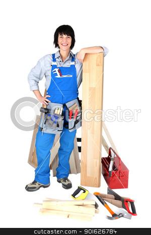 Female carpenter with tools stock photo, Female carpenter with tools by photography33