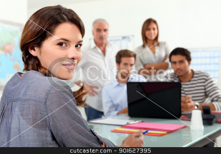Students gathered around laptop in class stock photo, Students gathered around laptop in class by photography33