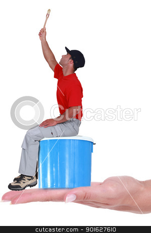 Painter on blue paint can stock photo, Painter on blue paint can by photography33