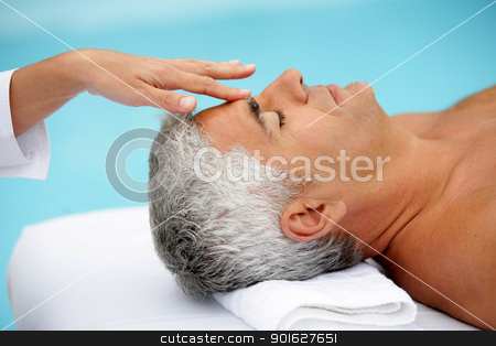 Mature man having facial massage stock photo, Mature man having facial massage by photography33