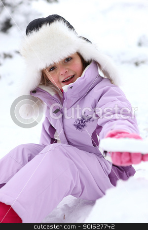 Little girl sitting on the snow stock photo, Little girl sitting on the snow by photography33