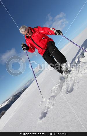 Mature man skiing stock photo, Mature man skiing by photography33