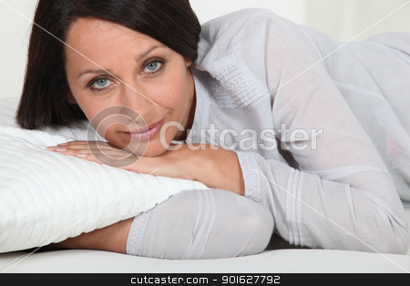 Woman lying on her bed stock photo, Woman lying on her bed by photography33
