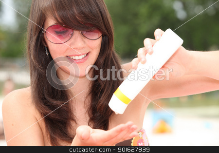 Young woman protecting herself from the sun's harmful rays stock photo, Young woman protecting herself from the sun's harmful rays by photography33