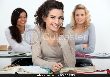 University students at desks stock photo, University students at desks by photography33