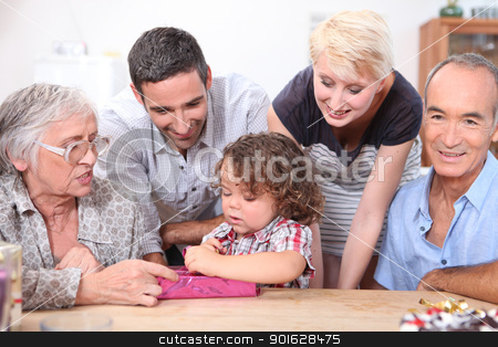 little boy opening a birthday present stock photo, little boy opening a birthday present by photography33