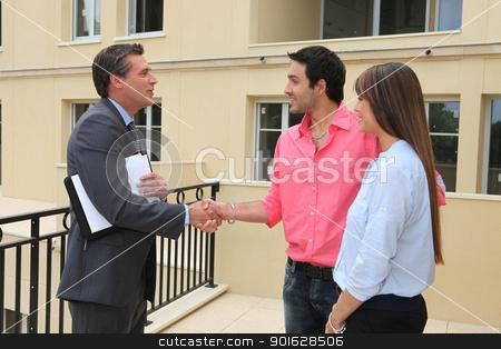 Estate agent shaking customers hand stock photo, Estate agent shaking customers hand by photography33