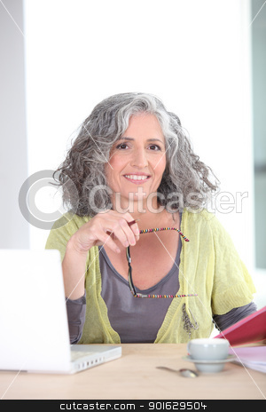 Older woman using a laptop computer stock photo, Older woman using a laptop computer by photography33