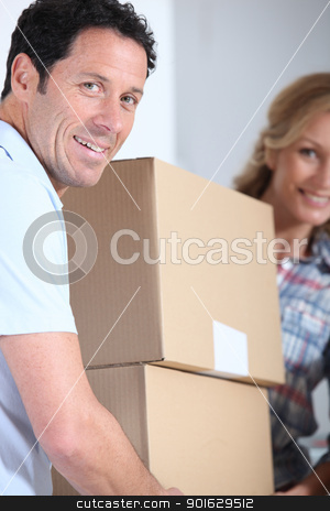 Couple carrying boxes stock photo, Couple carrying boxes by photography33