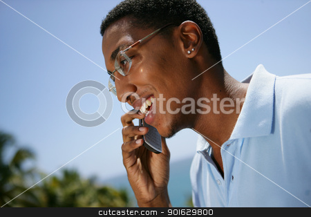 Overjoyed man talking on his mobile phone stock photo, Overjoyed man talking on his mobile phone by photography33