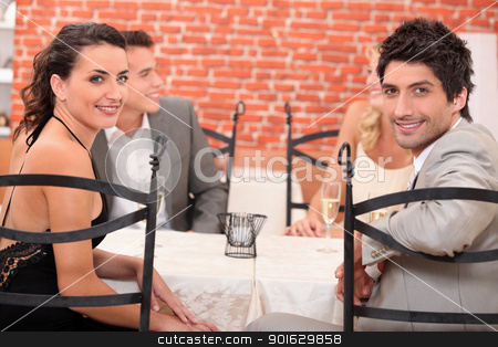 Two couples dining out in a restaurant stock photo, Two couples dining out in a restaurant by photography33