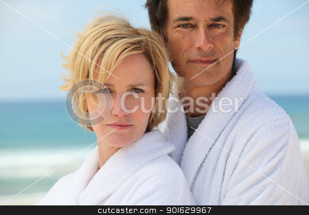 Couple by the sea stock photo, Couple by the sea by photography33
