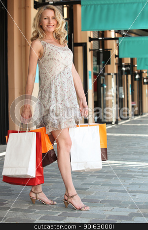 Woman with shopping bags outside boutiques stock photo, Woman with shopping bags outside boutiques by photography33