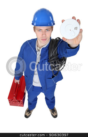 Electrician holding up smoke alarm stock photo, Electrician holding up smoke alarm by photography33