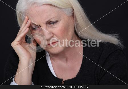 Senior woman with a headache stock photo, Senior woman with a headache by photography33