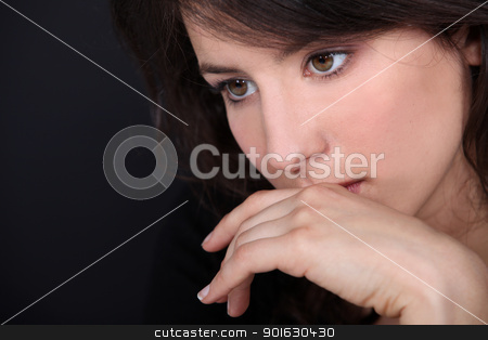 Pensive woman's face stock photo, Pensive woman's face by photography33