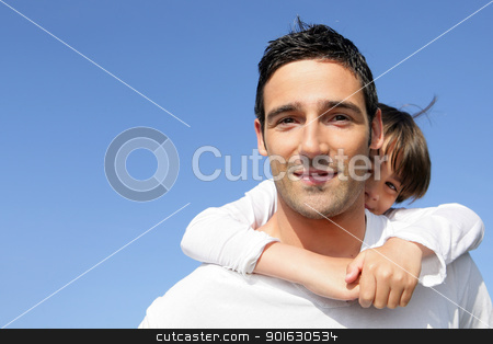 Young boy riding piggy-back on his father's back stock photo, Young boy riding piggy-back on his father's back by photography33