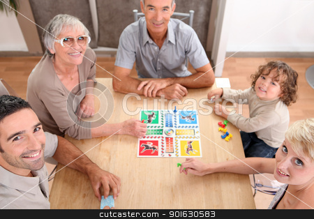 Family playing board games. stock photo, Family playing board games. by photography33