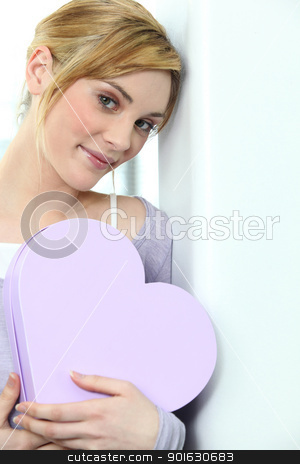 a blonde woman with a heart shaped box stock photo, a blonde woman with a heart shaped box by photography33