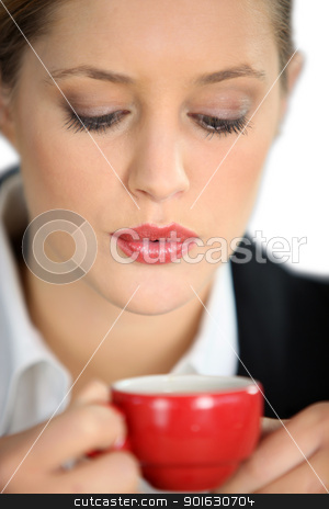 Woman blowing a hot drink stock photo, Woman blowing a hot drink by photography33