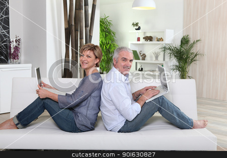 Couple each working on their own laptop stock photo, Couple each working on their own laptop by photography33
