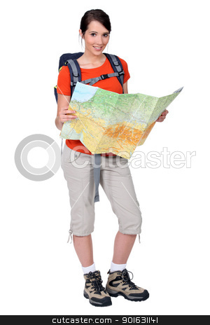 Female backpacker studying a map stock photo, Female backpacker studying a map by photography33