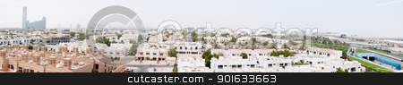Dubai covered by sand haze, panorama stock photo, Dubai, UAE - August 29, 2011: Panorama of the city covered by sand haze with the international airport on the right part, skyscrapers on background and private buildings on the front.  by Iryna Rasko