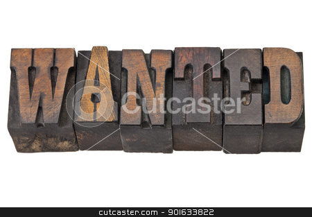 wanted word in western style type stock photo, wanted - isolated word in vintage letterpress wood type - French Clarendon font popular in western movies and memorabilia by Marek Uliasz