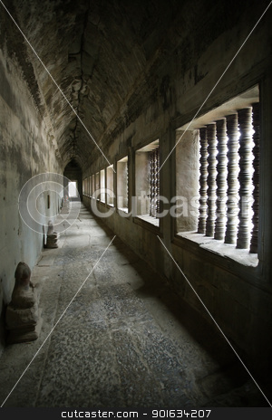 Corridor from Angkor temples stock photo, A corridor of the Angkor temples in Siem Reap, Cambodia.  The heads of the Buddha statues have been stolen or vandalized over the years of the temples neglect. by © Ron Sumners