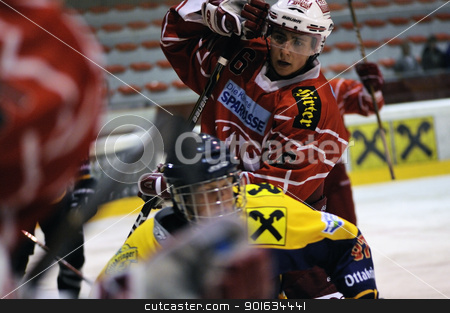 icehockey game action stock photo, ZELL AM SEE; AUSTRIA - AUG 30: Austrian National League. Number 6 of KAC II is hooking a player of EK Zell am See. Game EK Zell am See vs KAC II (Result 2-3) on August 30, 2011 in Zell am See. by www.ericfahrner.com