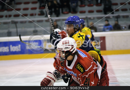 icehockey game action stock photo, ZELL AM SEE; AUSTRIA - AUG 30: Austrian National League. Number 21 of KAC II got a hit by a player of Zell am See. Game EK Zell am See vs KAC II (Result 2-3) on August 30, 2011 in Zell am See. by www.ericfahrner.com