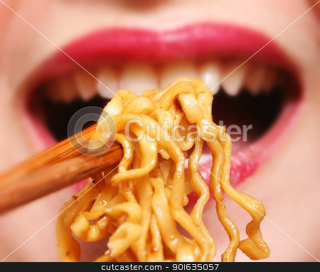 Young chinese woman eating noodles stock photo, Young chinese woman eating noodles for dinner by stuartmiles