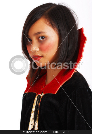 Vampire Costume On A Young Girl stock photo, Girl In Vampire Costume For Halloween Trick Or Treat by stuartmiles