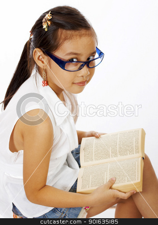 Small Girl Reading A Text Book stock photo, Small Girl Improving Her Education By Reading A Book by stuartmiles