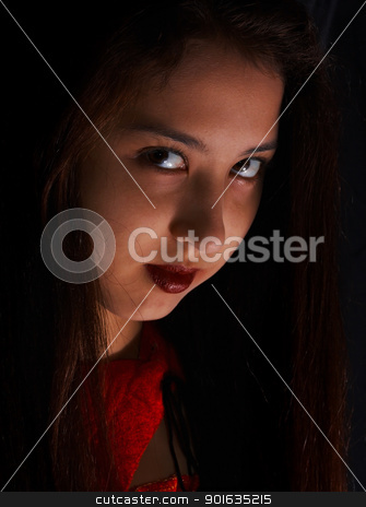 Scary Young Face At Halloween stock photo, Young Girl Making A Scary Face For Halloween by stuartmiles
