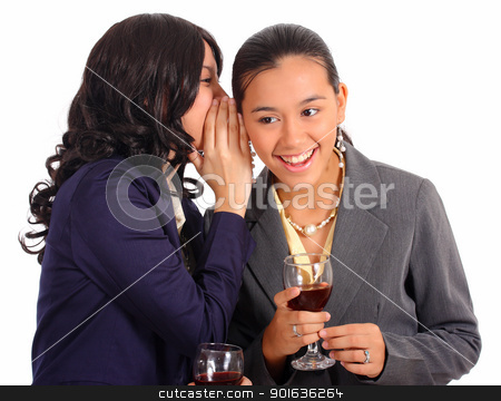 Two Female Officemates Sharing A Secret stock photo, Two Officemates Sharing Secrets And Gossips by stuartmiles