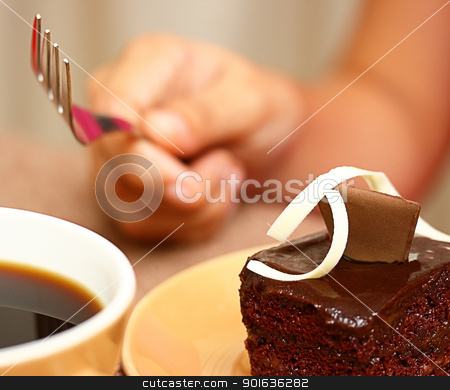 Eating Some Chocolate Cake With A Cup Of Coffee stock photo, Holding A Fork Ready To Eat Some Chocolate Cake And Drink Coffee by stuartmiles