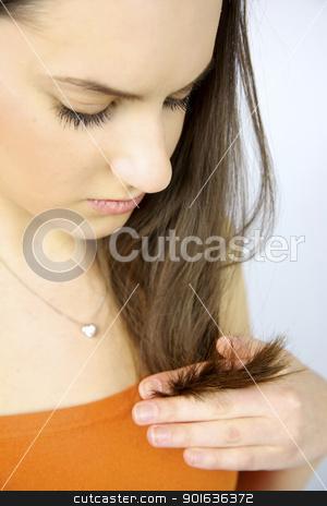 Female model looking unhealthy hair split ends stock photo, Female model looking unhealthy split ends of hair by federico marsicano