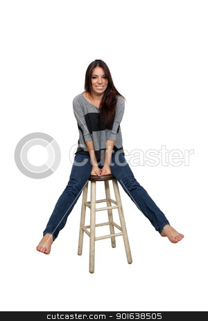 Casual Brunette on a Barstool (3) stock photo, A lovely young smiling and playful brunette in casual wardrobe sits on a barstool, isolated on a white background with generous copyspace. by Carl Stewart